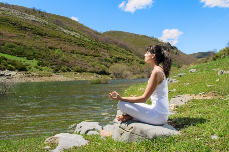 Photo for Young woman practices yoga and relax in nature. - Royalty Free Image