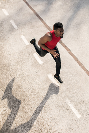 Photo for Top view of young black man running in the city, - Royalty Free Image