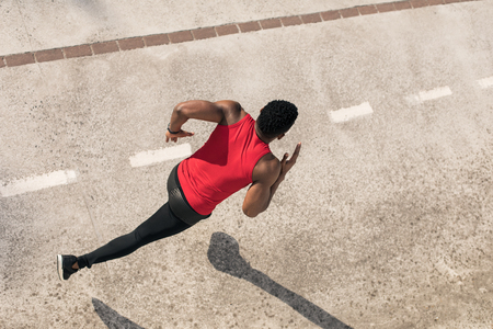 Foto de Top view of young black man running in the city, - Imagen libre de derechos