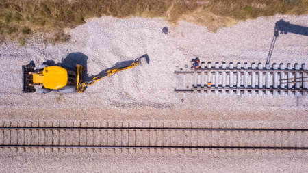 Foto de Railroad workers repairing a broken track. Repairing railway. Rail tracks maintenance process. - Imagen libre de derechos