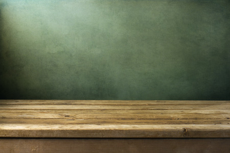 Background with wooden deck table on green grunge background