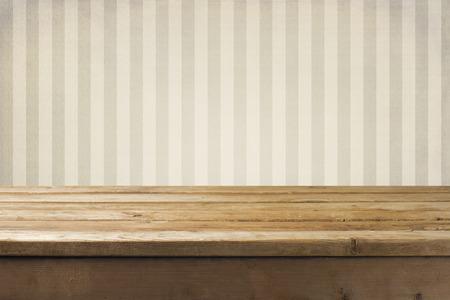 Photo for Vintage striped pattern wall and wooden deck tabletop - Royalty Free Image