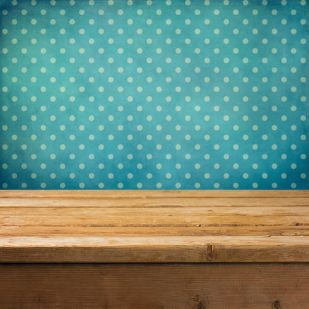 Background with wooden deck table and vintage polka dots wallpaper