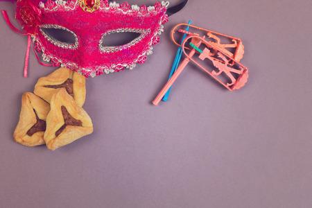Hamantaschen cookies, grogger and carnival mask