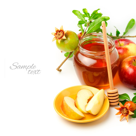 Honey and apples with pomegranate over white background