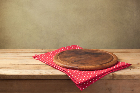 Background for product montage. Round wooden board with tablecloth.