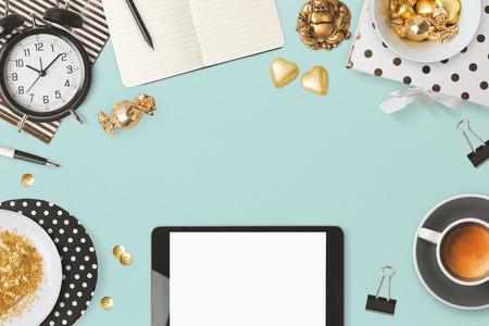 Website header design with digital tablet and feminine glamour objects over blue background