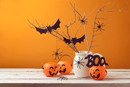 Halloween home decorations with spiders and pumpkin bucket for trick or treat