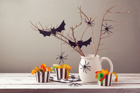 Halloween party decorations with spiders and candy