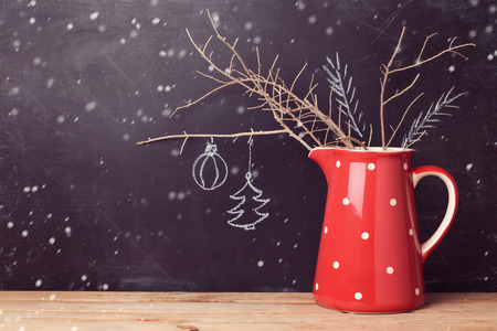 Photo for Christmas background with jug over chalkboard. Creative Christmas decorations. Alternative Christmas tree. - Royalty Free Image