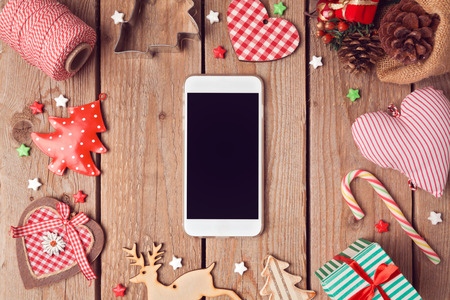 Photo pour Smart phone mock up with rustic Christmas decorations for app presentation. View from above - image libre de droit