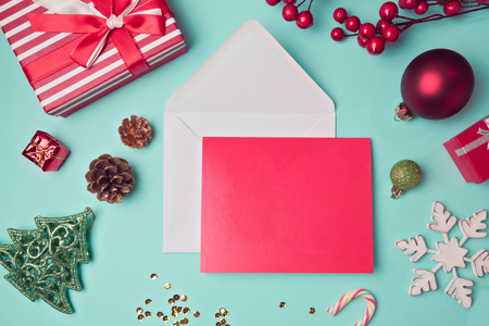 Greeting card mock up template with Christmas decorations. View from above