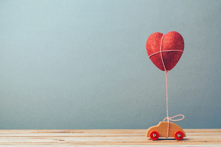 Photo for Valentine's day holiday celebration with toy car and heart shape - Royalty Free Image