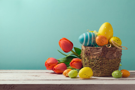 Photo for Easter egg decorations with flowers over blue background - Royalty Free Image