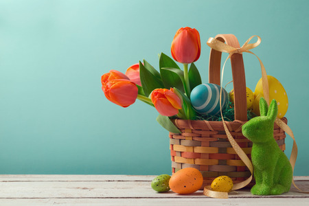Photo for Easter holiday basket with eggs, flowers and easter bunny - Royalty Free Image