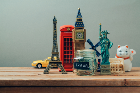 Photo pour Travel and tourism concept with souvenirs from around the world. Planning summer vacation, money budget trip concept. Saving money for vacation. - image libre de droit