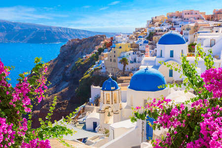 Photo for Santorini island, Greece. Oia town traditional white houses and churches with blue domes over the Caldera, Aegean sea. - Royalty Free Image
