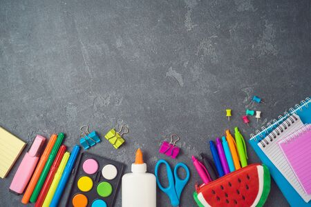 Photo pour Back to school background with school supplies on blackboard. Top view from above - image libre de droit