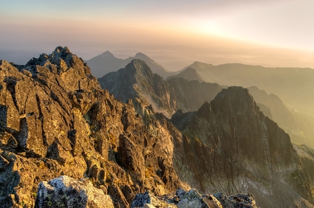 Summer landscape. Sunrise in mountains. View from Aries Rohy peak in the High Tatra Mountains, Slovakia.