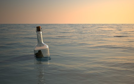 Bottle message floating around in calm ocean