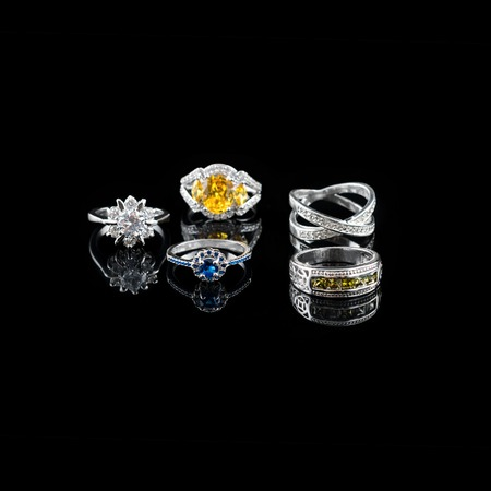 Photo for Collection of rings with colorful gems on black background - Royalty Free Image