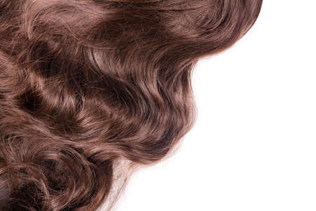 Photo for Brown hair texture. Wavy long curly light brown hair close up isolated on white as background with copy space for text. Hair extensions, materials and cosmetics, hair care.Hairstyle, haircut or dying - Royalty Free Image