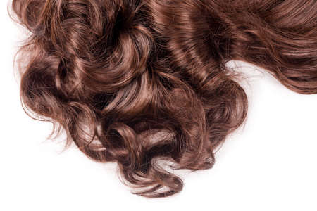 Photo for Brown hair texture. Wavy long curly light brown hair close up isolated on white. Hair extensions, materials and cosmetics, hair care, wig. Hairstyle, haircut or dying in salon. - Royalty Free Image