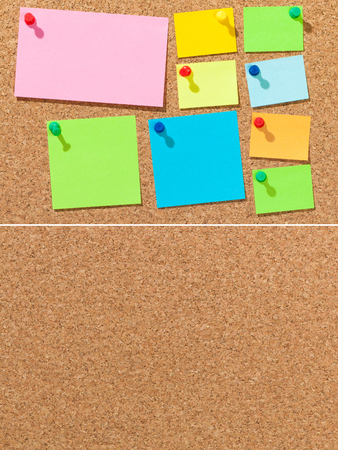 Colored sheets of paper on cork board for background; Pieces of paper in different sizes for memos and notes on brown background; Pin board