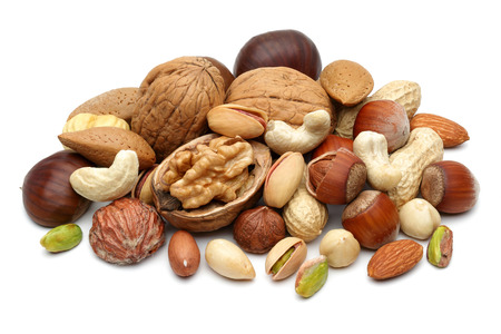 Foto de Mixed nuts isolated on white background - Imagen libre de derechos