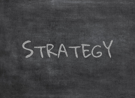 Photo pour Chalk and strategy write on chalkboard background to mean a concept - image libre de droit