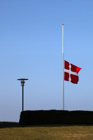 Flag on half pole, funeral