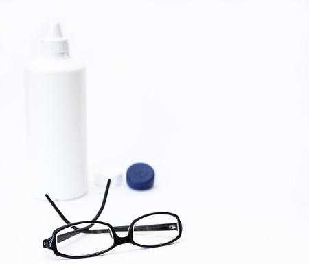 black glasses and contact lenses on white background