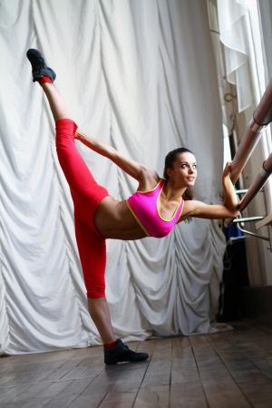 Young caucasian woman dancer is posing