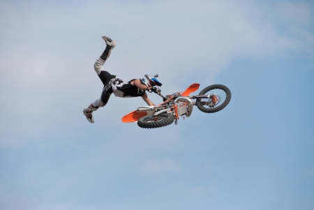 motocross rider flying through the air with his bike.