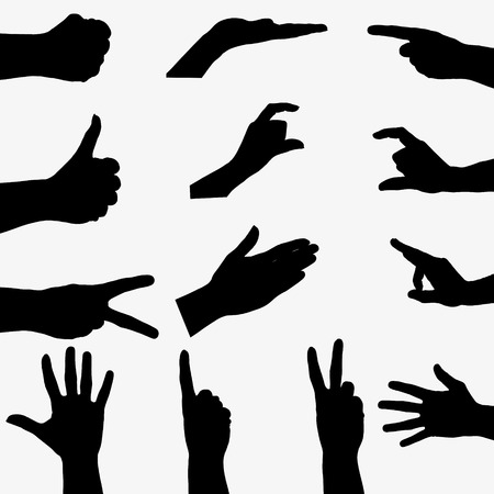 Few black silhouette hand on gray background.