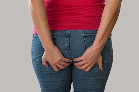 Photo pour Woman with health problems. Hemorrhoids and intestinal issues. - image libre de droit