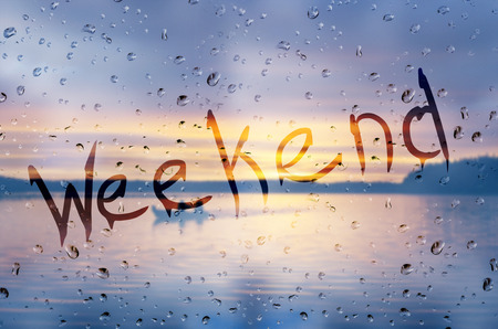 Rain on glass with Weekend text
