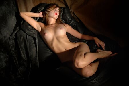 Photo pour Sexy and cute young naked girl on the couch - image libre de droit