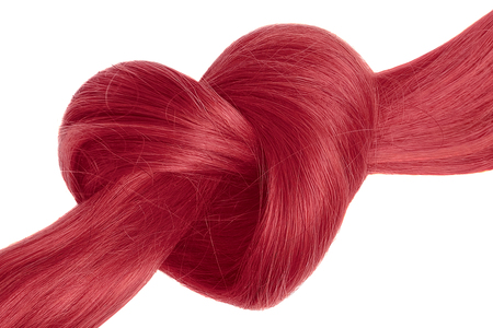Photo pour Pink hair knot in shape of heart, isolated on white - image libre de droit