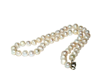 pearl necklace closeup on white background