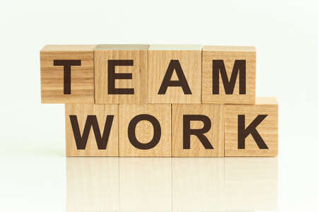 Photo pour Team Work - text on wooden cubes on a gradient background. HUMAN RESOURCES the ability of a group of people to work well together - image libre de droit