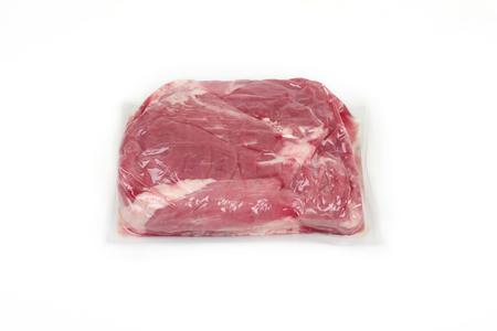 Foto de Fresh pork meat in vacuum packed, isolated on a white background - Imagen libre de derechos