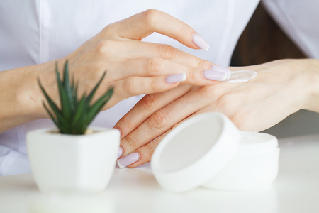 Photo pour Scin Care. Scientist hands testing texture of beauty products - image libre de droit