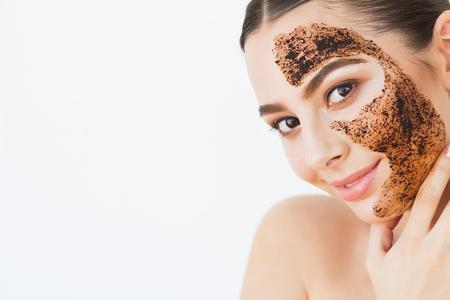 Photo pour . Young CFace Skincareharming Girl Makes a Black Charcoal Mask on Her Face - image libre de droit
