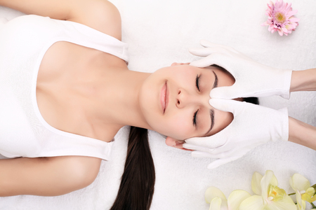 Skin And Body Care. Close-up Of A Young Woman Getting Spa Treatment At Beauty Salon. Spa Face Massage. Facial Beauty Treatment. Spa Salon.