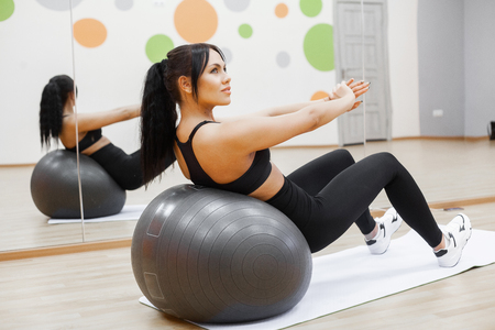 Photo for Fitness. Young woman training with Fitness Ball - Royalty Free Image
