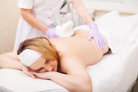 Photo pour Body Care. Woman is in the process at the clinic lipomassage - image libre de droit