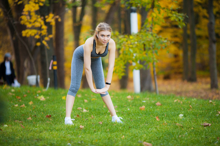 Photo for Fitness. Woman doing stretching exercise on park - Royalty Free Image