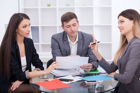 Photo pour Meeting with agent in office, buying renting apartment or house, buyers of real estate ready to conclude a deal, family couple shaking hands with realtor after signing documents for realty purchase - image libre de droit