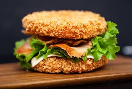 Photo pour Sushi Burger with a variety of tasty ingredients on a dark background - image libre de droit